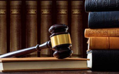 judge-gavel-on-a-book-law-books-background-wooden-desk-e1622361337922.jpg